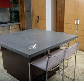 Precast Solid Concrete Countertop in Steel Reserve with custom conch shell inlay for a private Residence in Miami, Florida.