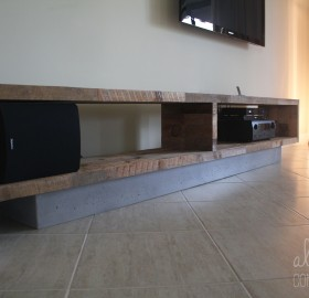 Alternative Constructors fabricated a reclaimed oak barnwood and concrete base entertainment center for a private residence.