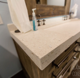 White concrete slot drain ramp sink with tabby oyster shell aggregate