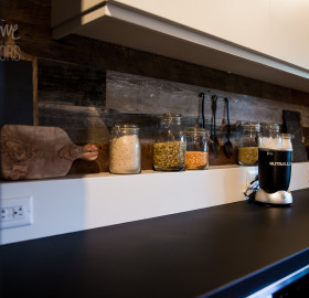 Jet Black Concrete Kitchen Countertop and Reclaimed Wood Backsplash