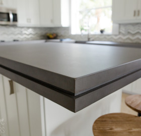 Edge banded concrete kitchen island